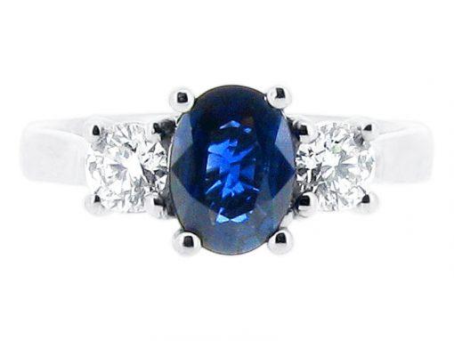椭圆形蓝色蓝宝石和圆形辉煌的订婚戒指 -  er 1189